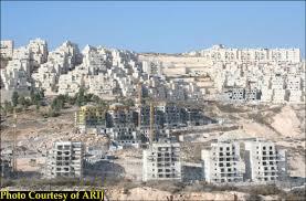 Despite Settlement Freeze, Buildings Rise