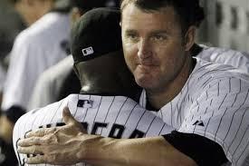 Jim Thome hugs someone else