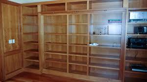 Custom Bookshelves Cost by Hidden Pivot Bookcase Installation Thisiscarpentry