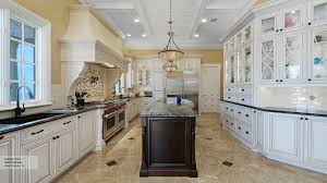 Kitchen Cabinets And Islands by White Kitchen Cabinets With A Dark Grey Island Omega