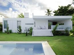 white contemporary house in brazil with swimming pool garden playuna