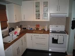 brown white colors cabinets shelves black color granite