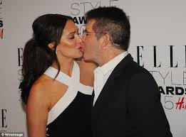 Simon Cowell and Lauren Silverman attend Elle Style Awards          Daily Mail Quick peck  They weren     t shy about showing off their dedication to each other