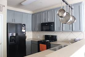 grey kitchen cabinets with black appliances outofhome
