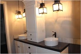 Hanging Bathroom Vanities by Brown Finish Maple Wood Storage Vanity Cabinet Black Towel Beside