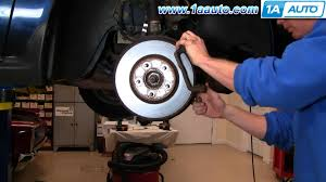 how to install replace front disc brakes ford taurus mercury sable