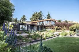 tavonatti house modern coastal style complements distant ocean views