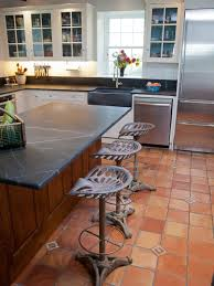 kitchen floor farmhouse designswith white cabinets and terracotta