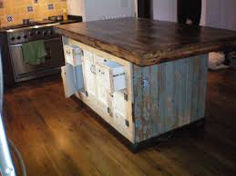 forever interiors large kitchen island with cabinets and drawers