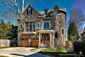 victorian home exterior with a castle aura thanks to the stone