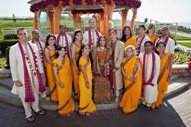 Hindu Wedding Planners Thrive in the United States   The New York     India Ink   The New York Times Rachna Krishan in an orange bridal outfit and Jordan Newmark  to her left  with