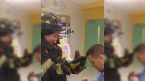 FDNY firefighter proposes to teacher girlfriend during fire safety     FDNY firefighter proposes to teacher girlfriend during fire safety lesson at Queens school   abc ny com