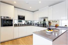 kitchen stainless steel countertops with white cabinets cottage
