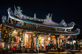 lighted chinese house with people at nighttime free image peakpx