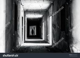 walkway abandoned building scary woman inside stock photo