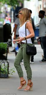 ideas about Jennifer Aniston Style on Pinterest   Jennifer     Jennifer Aniston pats her tum while showing off fuller figure in New York   Daily Mail
