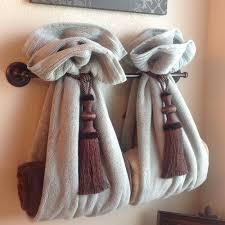 diy decorative bath towel storage inspiration using two drapery