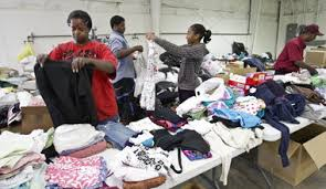 Volunteers, from left, Yvonne Gidden, Maximillion Gidden, Karen Arnold and Bernard Gidden, sort clothes donated at the Adventist Disaster Response warehouse ... - 9540593-large