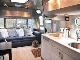 pretty airstream trailer interior with comfortable leather sofa