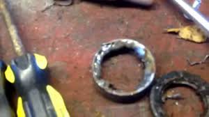 how to remove honda atv swingarm bearings part 1 look at