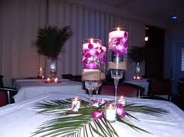 Purple Floating Candles For Centerpieces by Tropical Wedding Centerpiece Real Orchids And Sand With A