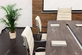 modern conference room table a large table and chairs in a modern conference room stock photo