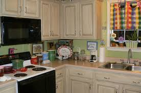 How To Paint Kitchen Cabinets Like A Pro Painted Kitchen Cabinets Grande Distressed Kitchen Cabinets Then