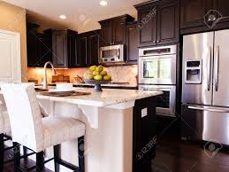 white kitchen cabinets with dark wood flooring amazing home design