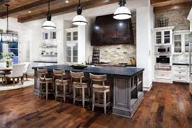 dining room white target barstools on dark pergo flooring with
