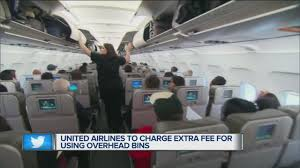 United Airline Baggage by United Airlines To Charge Extra Fee For Using Overhead Bins Youtube