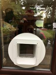 catflap in glass door keep unwanted animals out of your home with the sureflap pet door