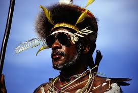"Richard James: ""A Dani man at a festival in the Baliem valley, Irian Jaya. The juxtaposition of the Aviator-style shades and traditional costume make for ... - Richard-James-001"