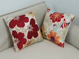 yearn grey and white decorative pillows tags red decorative
