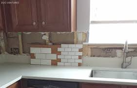 White Tile Kitchen Backsplash Duo Ventures Kitchen Makeover Subway Tile Backsplash Installation