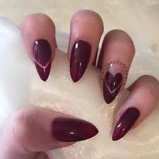 burgundy stiletto nails with negative chevron design and love