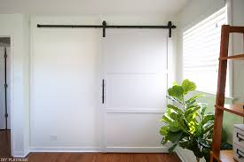 Diy Barn Doors by How To Build And Hang A Diy Barn Door On A Budget In Your Home