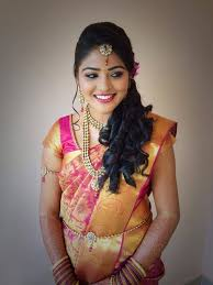 makeup back brushed hair with curls traditional south indian bride wearing bridal saree and jewellery reception pauline