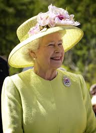 United Kingdom   Wikipedia Wikipedia Elderly lady with a yellow hat and grey hair is smiling in outdoor setting