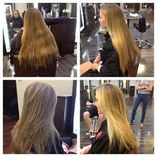 long layered haircut with sun kissed highlights dres hair salon