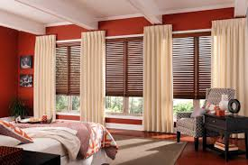 interior design red wall with white window and wood bali blinds