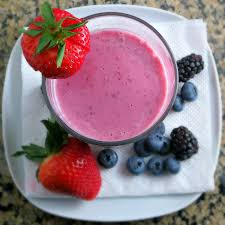 A glass of berrie smoothie.