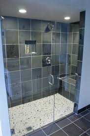 interior glass shower room with black wall tile and stainless