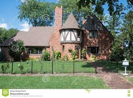 red brick english tudor house with round turret stock photo