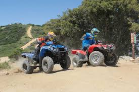 dirt wheels magazine honda recon 250 vs kawasaki brute force 300