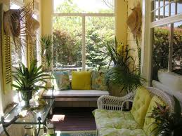 small sunroom with wicker chair and houseplants good plants in