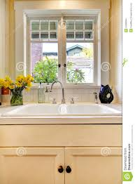 kitchen sink and white cabinet with window stock images image