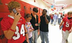 cellular phone  students in Alabama    Kids Encyclopedia     Photograph High school students in Florence  Alabama  talk on cell phones or use