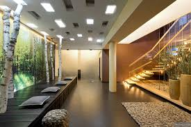 floating stairwell with pillars and glass panels pebble look rug
