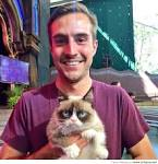 Grumpy Cat and Ridiculously Photogenic Guy at Disneyland. | Funny ... lefunny.net