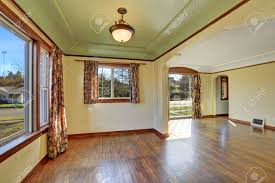 empty room interior of tudor style home with colorful window